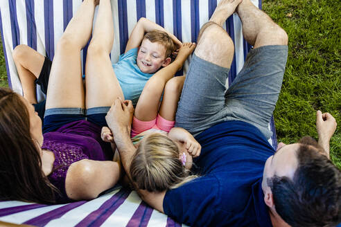 Family relaxing on hammock during weekend - AWAF00022