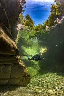 Man scuba diving in Taugl river, Austria - YRF00253