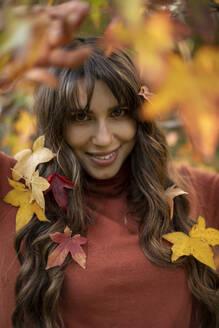 Beautiful woman in autumn park - AXHF00050