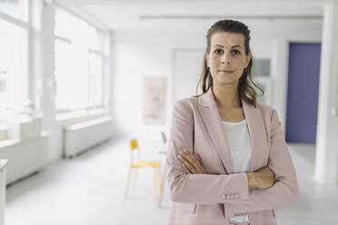 Portrait of businesswoman standing in office - GUSF05002