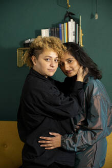 Portrait of lesbian couple embracing each other - AXHF00072
