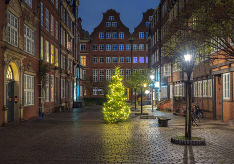 Germany, Hamburg, Composers Quarter and Christmas decorations in city street - RJF00844