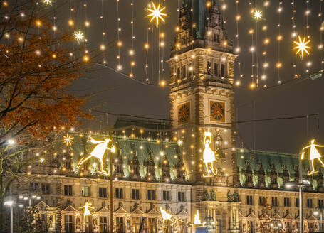 Germany, Hamburg, Town hall and Christmas decorations in city street - RJF00850