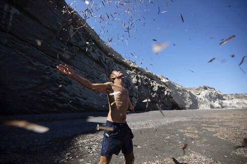 Happy man on the beach, Santorini, Greece - AXHF00099