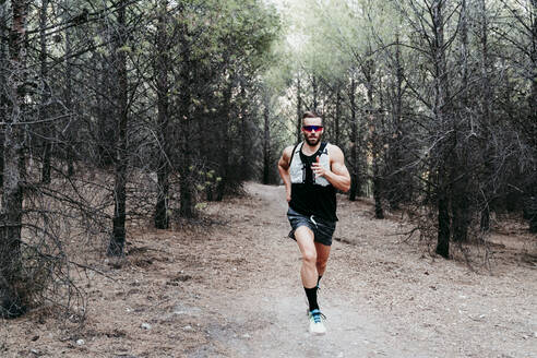 young man outdoors in the mountain running and doing trail, Madrid, Spain - EBBF02271