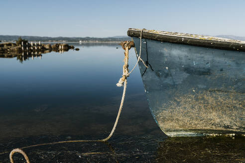 Abandoned boat in lake against clear sky at natural park, Ebro delta, Spain - AFVF08072