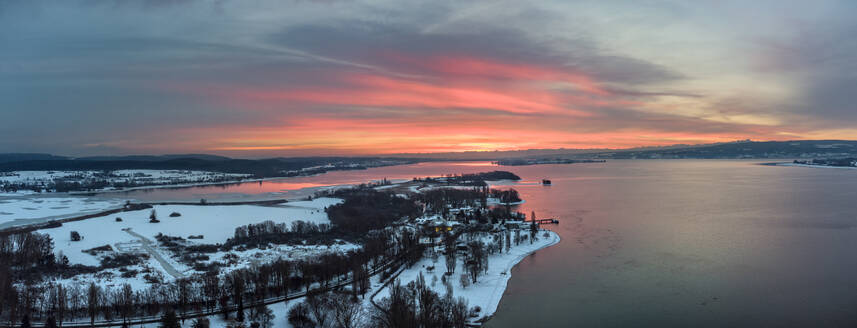Germany, Baden-Wurttemberg, Radolfzell, Aerial view of snow-covered Mettnau peninsula at sunset - ELF02346