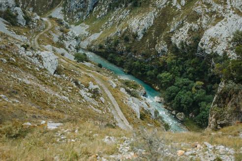 Cares trail by flowing river at Picos De Europe National Park, Asturias, Spain - DMGF00431