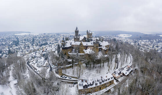 Germany, Hesse, Braunfels, Helicopter panorama of Braunfels Castle and surrounding town in winter - AMF09057