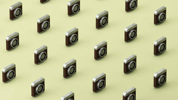 Three dimensional pattern of old-fashioned camera standing in rows against green background - JPSF00044
