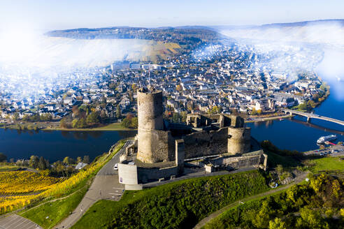 Germany, Rhineland-Palatinate, Bernkastel-Kues, Helicopter view of fog floating over Landshut Castle, Moselle and surrounding town in summer - AMF09115