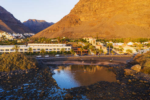Spain, Valle Gran Rey, Drone view of town at edge of La Gomera island at dusk - SIEF10105
