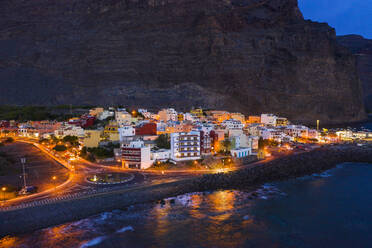Spain, Valle Gran Rey, Drone view of town at edge of La Gomera island at dusk - SIEF10108