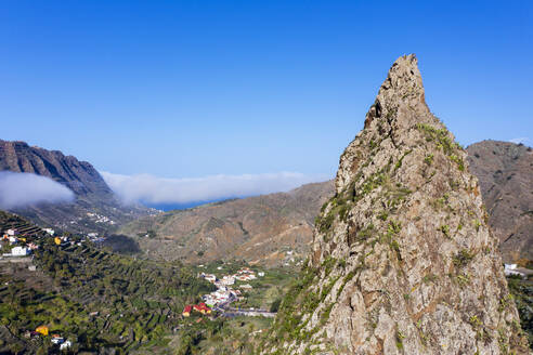 Spain, Hermigua, Drone view of Roques de San Pedro and small town in Garajonay National Park - SIEF10114