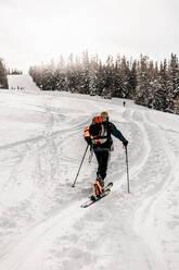 Caucasian senior man skiing on snow during vacation - DAWF01775