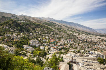 Old town amidst trees against cloud sky at Mali I Gjere, Gjirokaster, Albania - MAMF01640