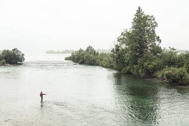 Fisherman doing fly-fishing in Loisach river at Kochelsee, Bavaria, Germany - WFF00451