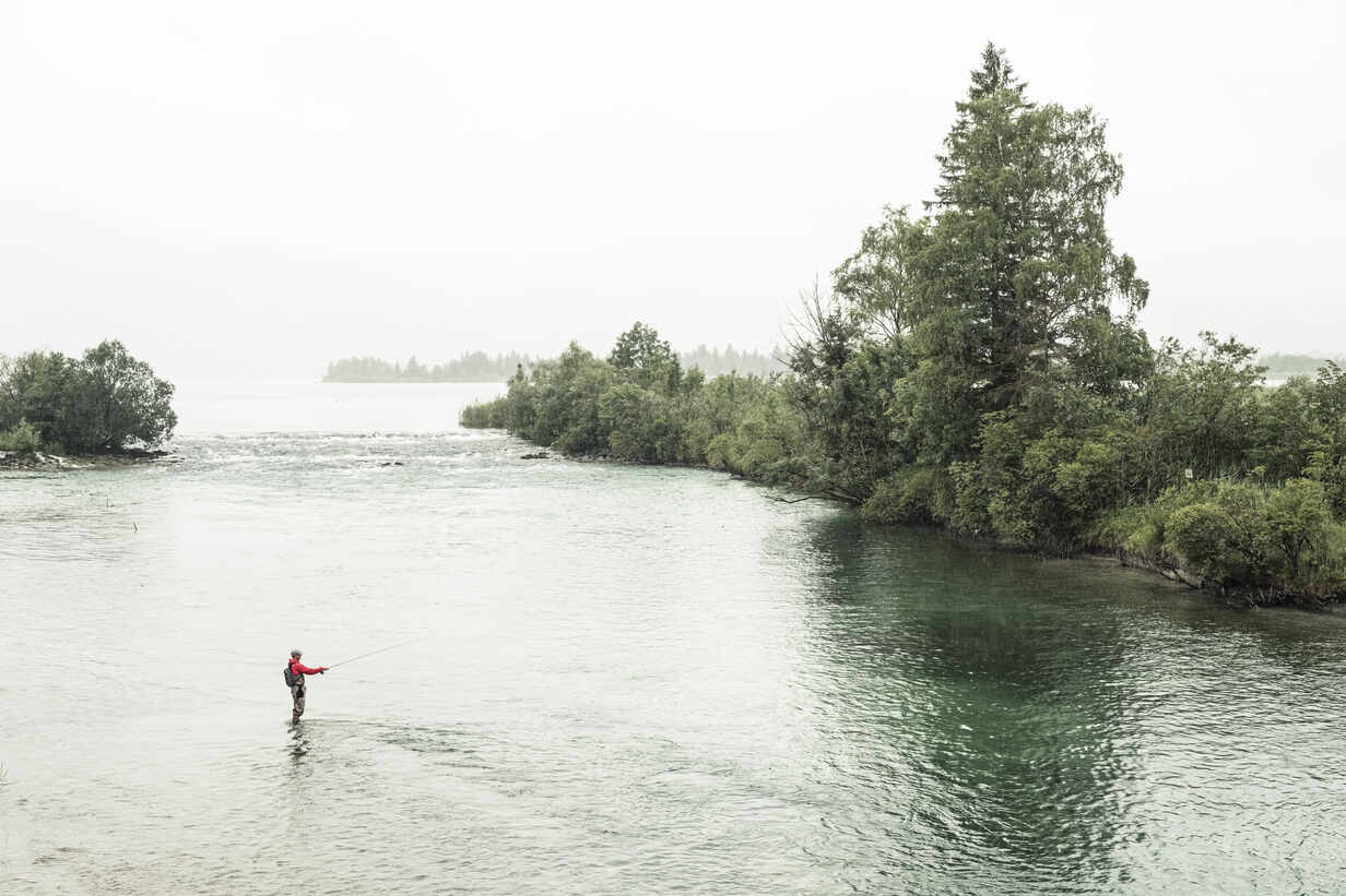 Fisherman doing fly-fishing in Loisach river at Kochelsee, Bavaria, Germany - WFF00451 - Wilfried Feder/Westend61