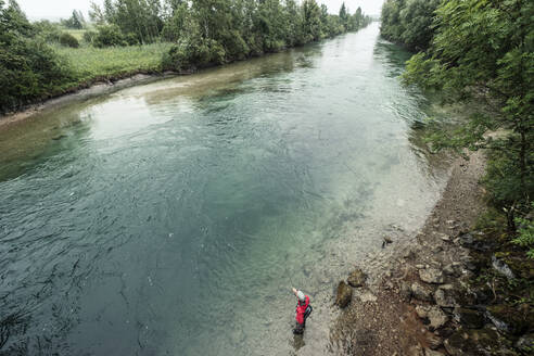 Expertise doing fly-fishing while standing in river at Loisach river at Kochelsee, Bavaria, Germany - WFF00454