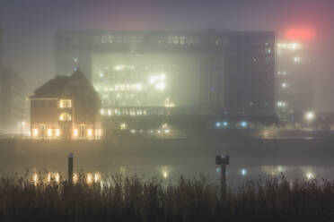 Germany, Hamburg, City architecture in fog - KEBF01804