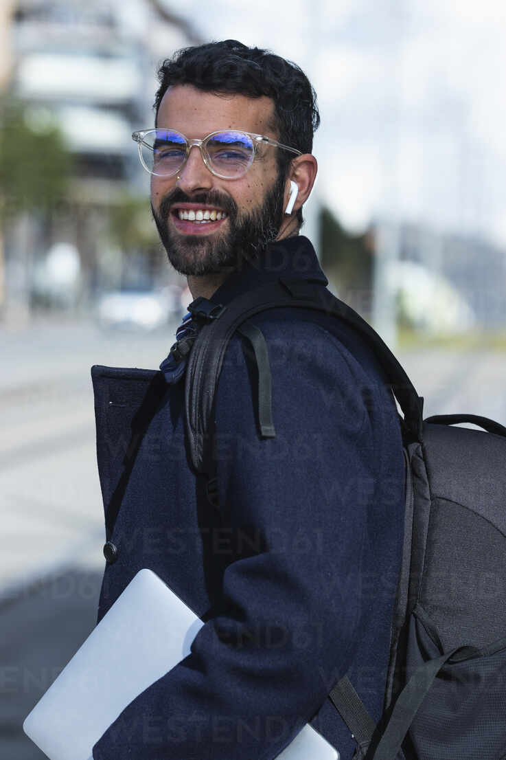 Smiling male entrepreneur in eyeglasses with digital tablet - PNAF00772 - NOVELLIMAGE/Westend61