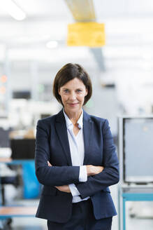 Mature businesswoman with arms crossed at office - JOSEF03700