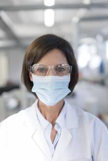 Female technician in laboratory during COVID-19 - JOSEF03868