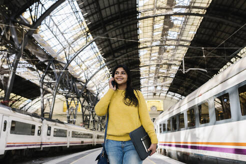 Barcelona, Catalonia, Spain - Indian woman standing in the train station - XLGF01233