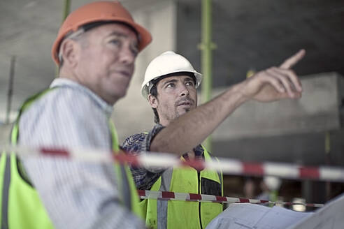 Two construction looking at plans, meeting on a construction site, Cape Town, South Africa. - AJOF01195